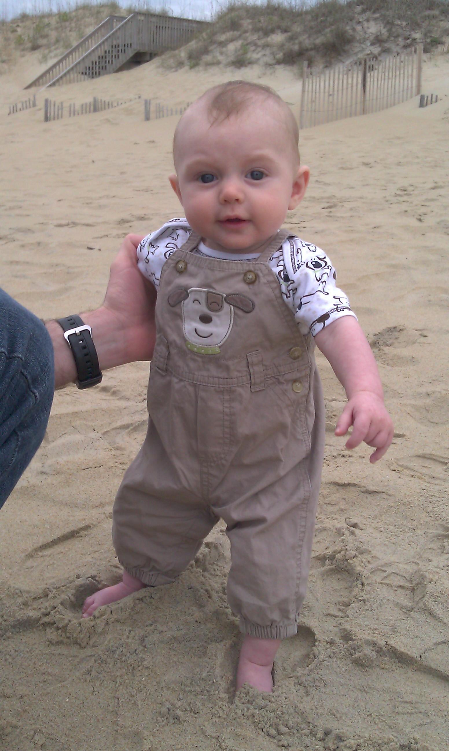 Harlan walking in the sand.
