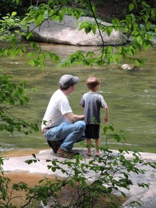 Picture of Harlan and Dad watching the Wye River.