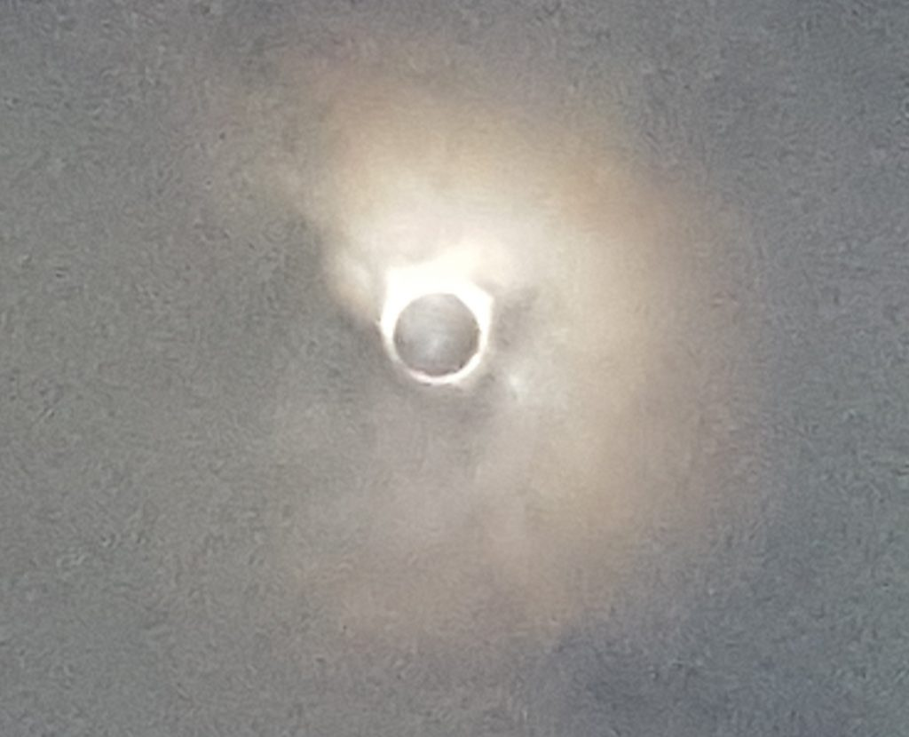Total solar eclipse with light cloud cover.