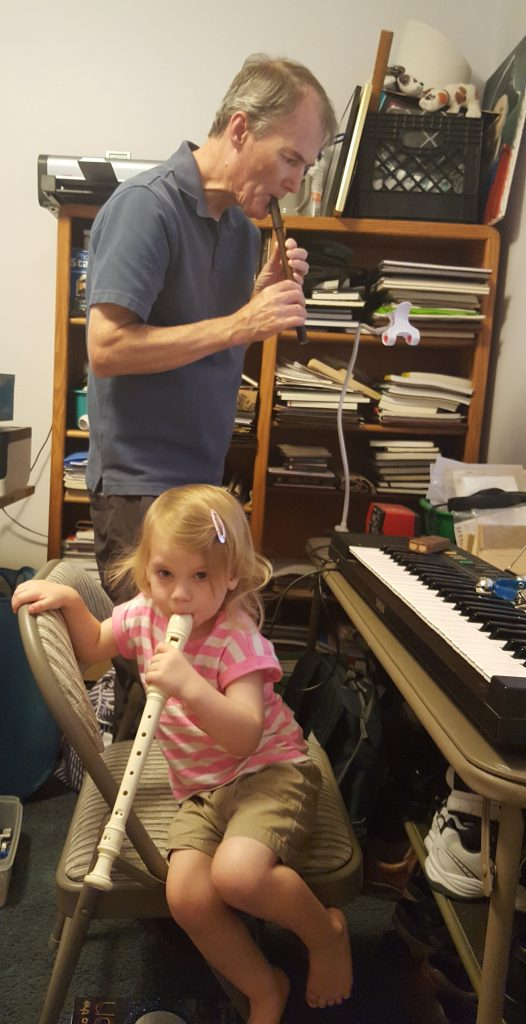 Papa and Elise playing music.
