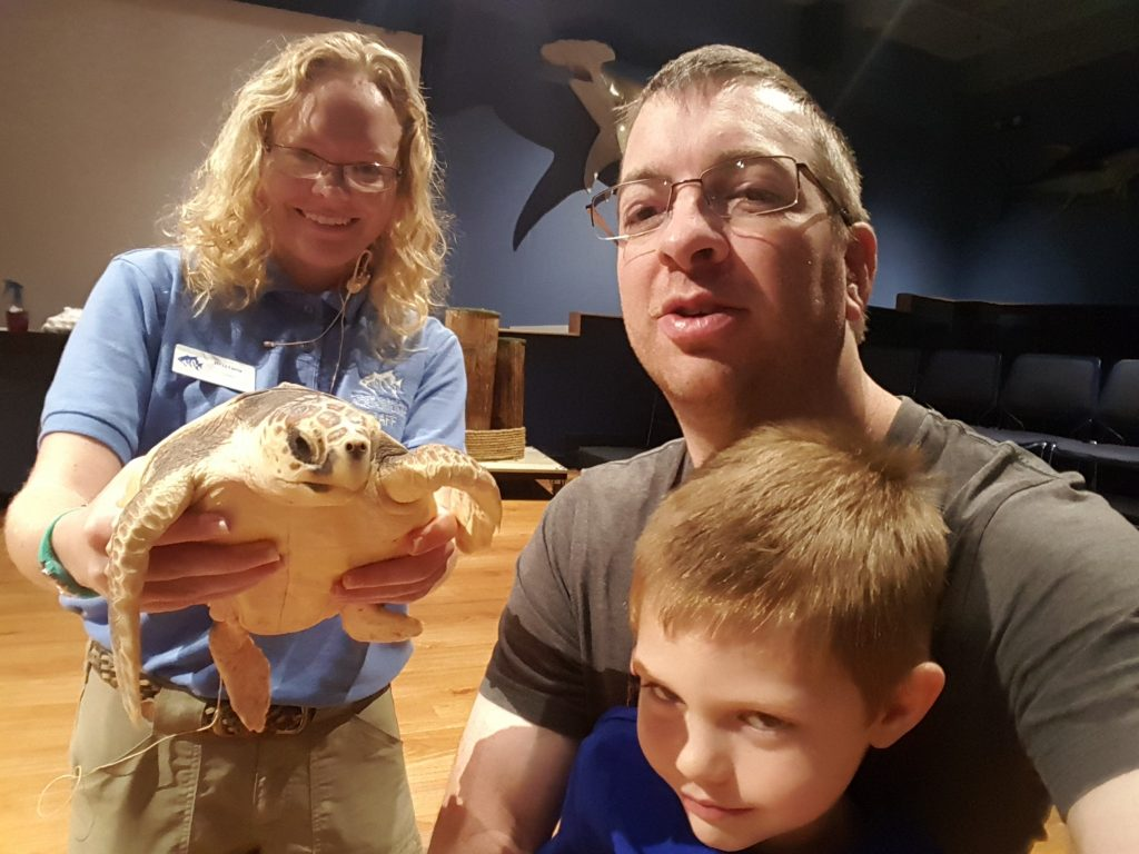 Eric, Harlan, Brittney (intern), and a sea turtle.