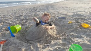 Harlan buried himself in the sand.