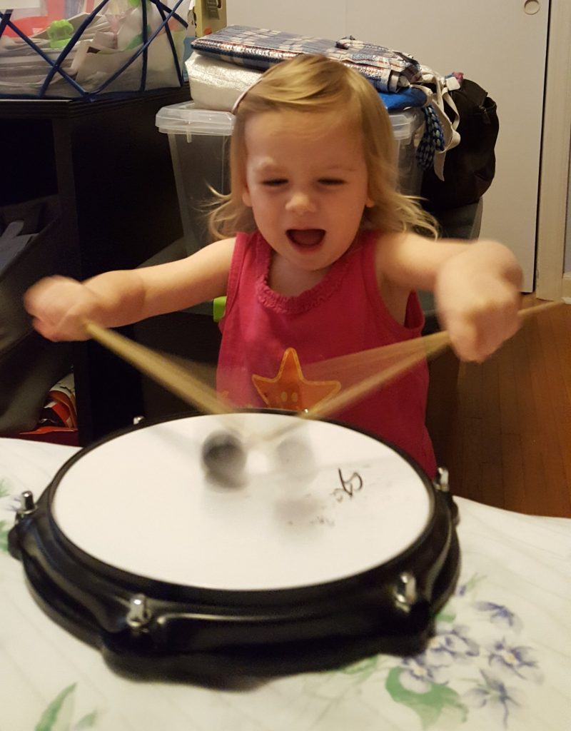 Elise playing the drum